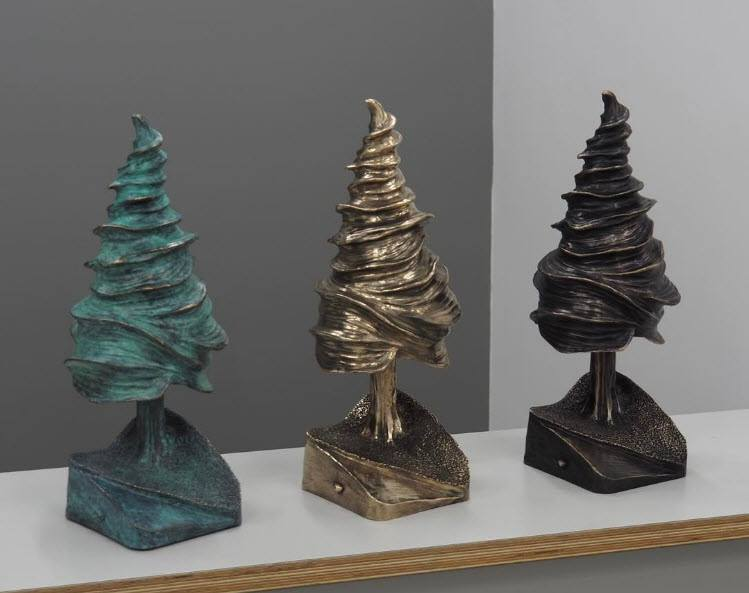 The three cedars above are cast in bronze. Each tree weighs 18lbs. The canopy moves freely and balances on the trunk. (See video below.)